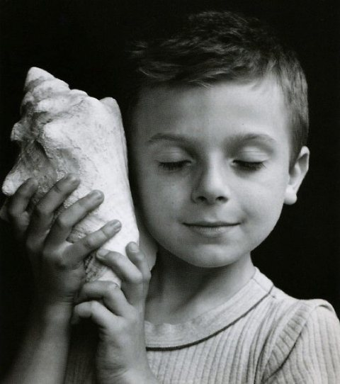 child with a shell-by-edouard-boubat
